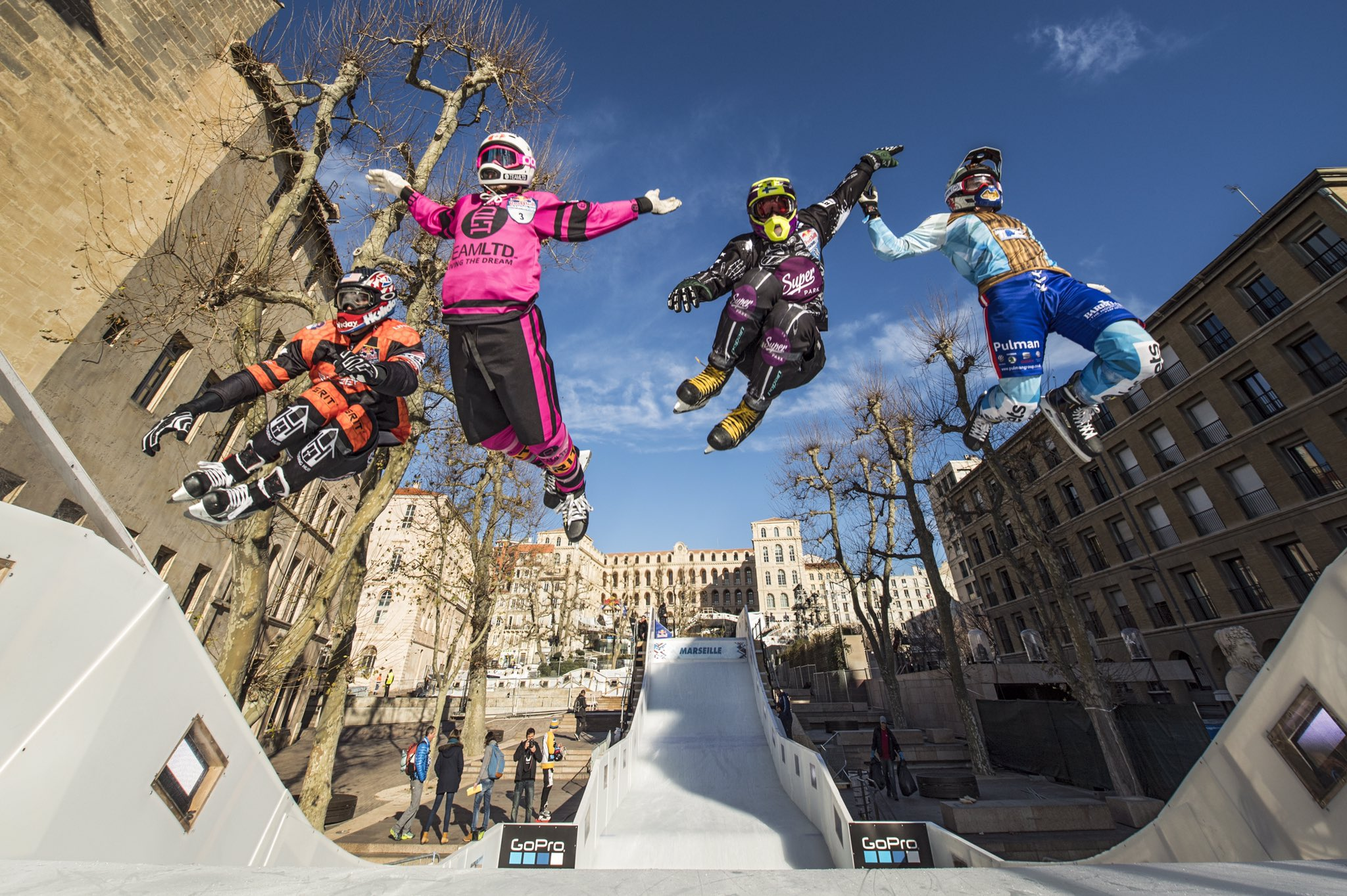 Cameron Naasz of the United States, Maxwell Dunne of the United States, Scott Croxall of Canada and Marco Dallago of Austria compete during the finals at the first stage of the ATSX Ice Cross Downhill World Championship at the Red Bull Crashed Ice in Marseille, France on January 14, 2017.